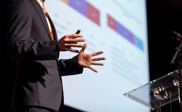 Midsection Of Man Giving Presentation At Podium