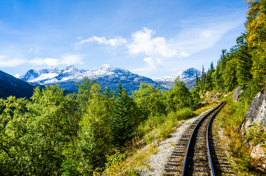 The stunning view of snow-capped mountains can be seen while travelling on the White Pass & Yukon Route Railroad built during the Klondike Gold Rush linking Skagway, Alaska with Whitehorse, Yukon.