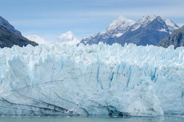 Close-up of Margerie Glacier with the Alaska mountains in the distance