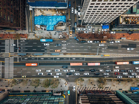 Drone View Of Cars On Road Amidst Buildings In City