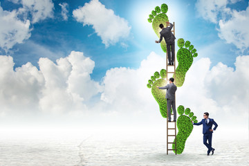 Carbon footprint concept with businessman