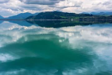 lake liptovska mara in slovakia. wondeful travel destination of high tatras mountain ridge. cloudy weather in springtime. reflection in the water
