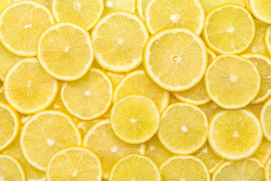 Fresh lemon slices pattern backgrond, close up