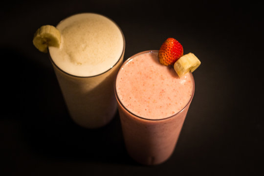 banana and strawberry smothies with black background