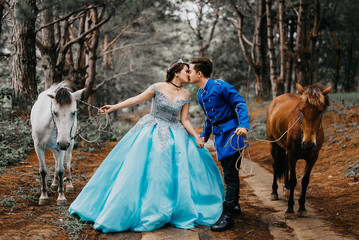 Wedding Couple Holding Horses While Kissing On Mouth In Forest