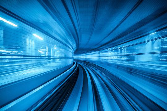 Blurred Motion Of Illuminated Blue Tunnel