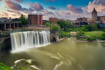 High Falls district in Rochester New York under cloudy summer skies Fotobehang