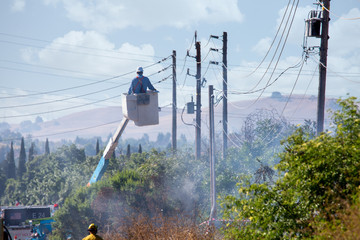Electrical worker repairs power lines that caused a fire