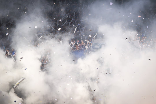 Fans With Smoke In Soccer Stadium