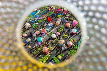 People Selling Food In Boats Seen Through Hole