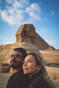 Couple Looking Away Against The Sphinx And Sky