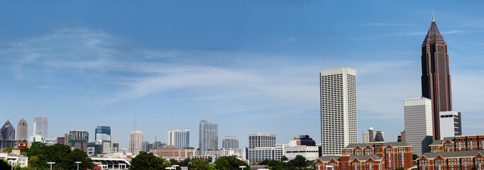 Wall Mural - Downtown Atlanta Skyline showing several prominent buildings, apartments, offices and hotels under a blue sky.