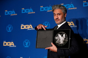 """Taika Waititi, director of """"Jojo Rabbit"""" poses while holding his nominee medallion at the 72nd Annual Directors Guild Awards in Los Angeles"""