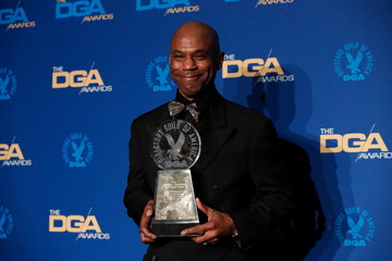 Arthur E. Lewis poses with his trophy after winning the Franklin J. Schaffner Achievement Award at the 72nd Annual Directors Guild Awards in Los Angeles,
