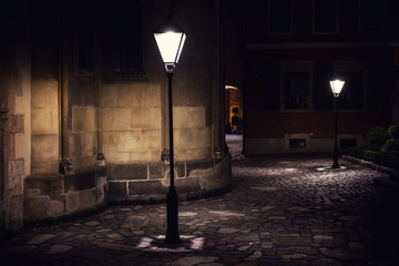 illuminated street at night. Old european city Fotobehang