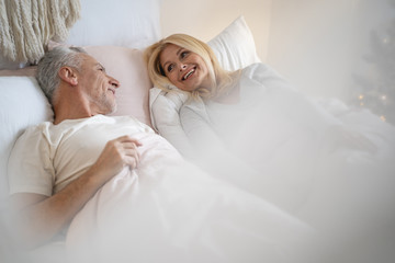Laughing at funny joke with beloved person stock photo