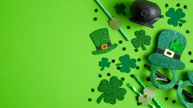 St Patricks Day banner design with Irish elf hats, pot of gold, shamrock leaf clovers, glasses on green background. Happy St. Patrick's Day concept. Greeting card template, poster, flyer mockup