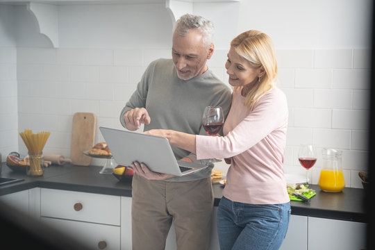 Couple drinking wine and choosing photos stock photo
