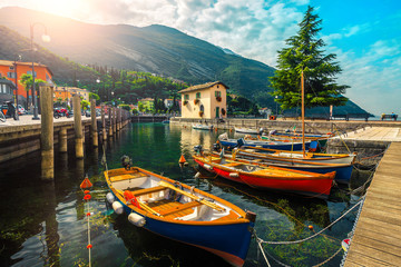 Wall Mural - Colorful fishing boats on the lake, Garda lake, Torbole, Italy