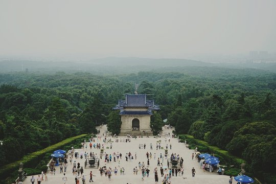 High Angle View Of Crowd Visiting Sun Yat-Sen Mausoleum Surrounded By Trees Against Sky