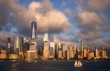 Fototapete - Lower Manhattan Skyline and moon rising at Golden Hour, NYC, USA