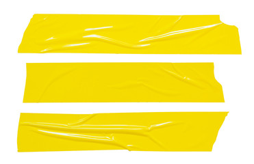 Sticker tape ripped torn pieces. Yellow adhesive tapes set isolated on white background