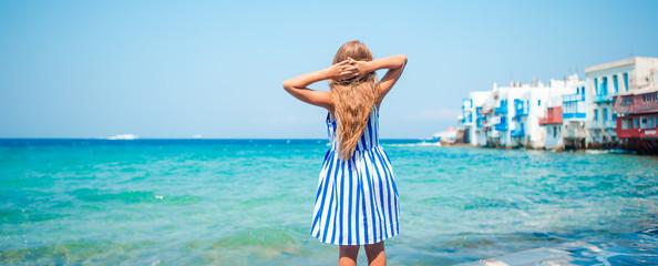Adorable little girl at Little Venice the most popular tourist area on Mykonos island, Greece.