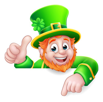 A Leprechaun St Patricks Day cartoon character giving a thumbs up, peeking over a sign and pointing at it