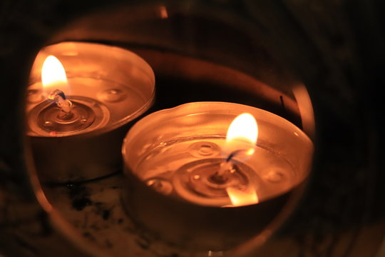 Candles burning in an oil burner within the home