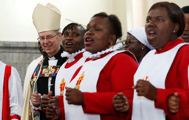 Archbishop of Canterbury Justin Welby joins the choir members as he attends a special service at the Anglican Church of Kenya St. Stephen's Cathedral along Jogoo road in Nairobi