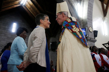 Archbishop of Canterbury Justin Welby talks to his wife Caroline Welby during a special service at the Anglican Church of Kenya St. Stephen's Cathedral along Jogoo road in Nairobi