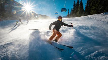Teenage skier braking during windy conditions