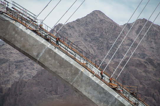 Workers On Mike O Callaghan Pat Tillman Memorial Bridge Against Mountains