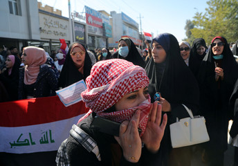 University students shout slogans, during ongoing anti-government protests in Kerbala