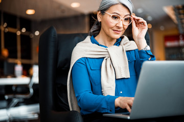 Curious entrepreneur in glasses working and smiling stock photo
