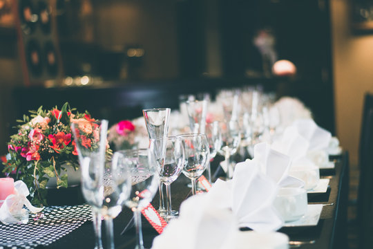 Close-Up Of Wine Glasses On Dining Table