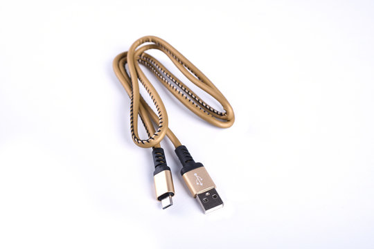 Folded USB lightning charging smartphone golden cable isolated over the white background