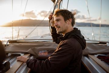 man on a sailing trip at sunset