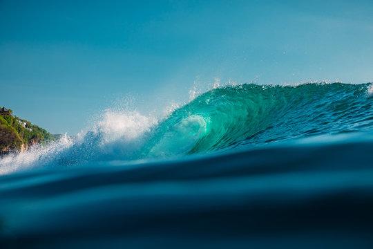 Barrel wave in sea. Blue wave with sun light