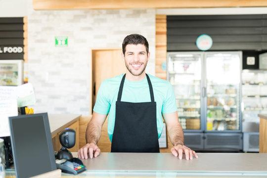 Confident Latin Owner In Supermarket