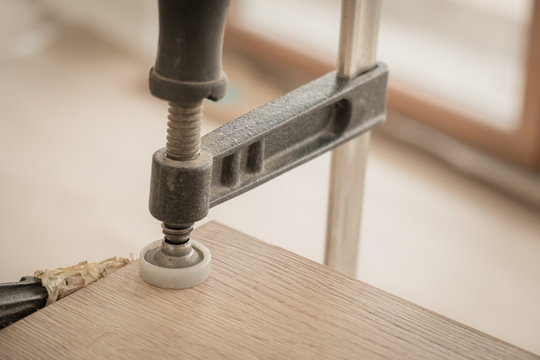 Wooden boards clamped together in the furniture assembly workshop