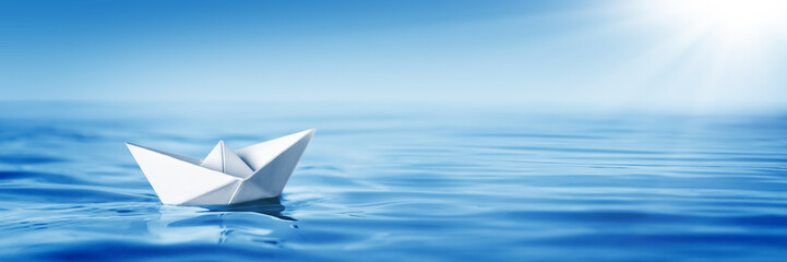 Small White Paper Boat In Big Ocean With Blue Sky And Sunshine - Business Opportunity/Vision Concept Fotomurales