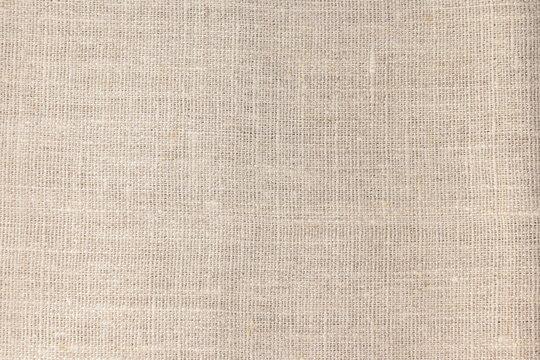 Beige linen fabric cotton for wallpaper design.