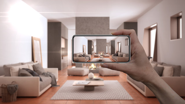 Hand holding smart phone, AR application, simulate furniture and interior design products in real home, architect designer concept, blur background, cosy living room with sofa