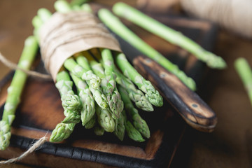 Fresh asparagus on a wooden table