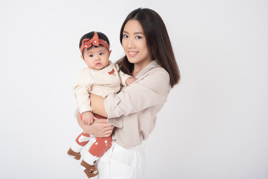 Asian mother and adorable baby girl are  happy on white background