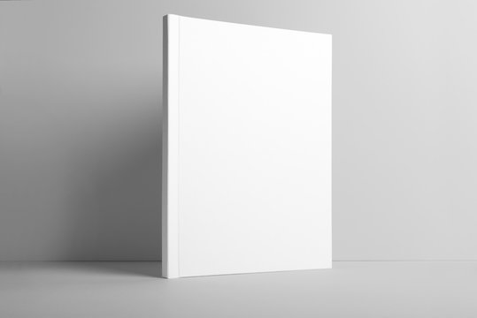 Real photo blank portrait A4, US-Letter, brochure magazine mockup isolated on gray background.