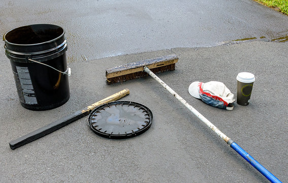 Some  items needed to reseal an asphalt driveway