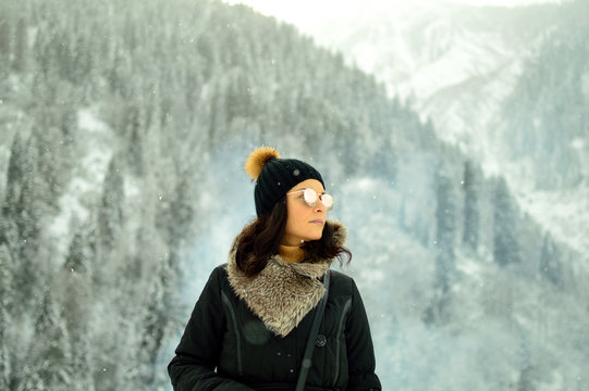 PORTRAIT OF A YOUNG WOMAN IN FOREST in snow
