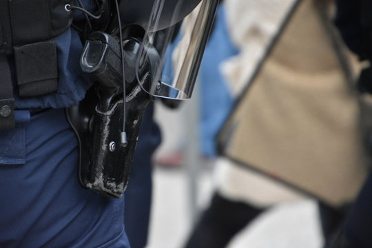 Close-up on a policeman's weapon